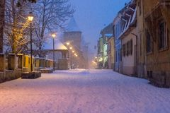 View to the Cetatii street in the historical center of Sibiu on a winter evening in Transylvania Region, Romania.  royalty free stock photos