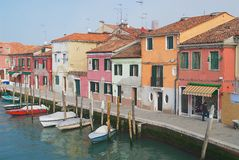 View to the channel, boats and buildings at the street in Murano, Italy. Royalty Free Stock Images