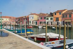 View to the channel, boats and buildings at the street in Murano, Italy. Royalty Free Stock Photography