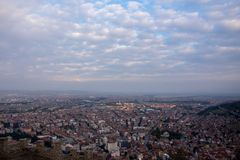 View to the city of Afyonkarahisar from castle. Looking Afyonkarahisar from the high Afyon castle during cloudy day Stock Photo