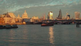 View to the City of London, Blackfriars Bridge and Saint Paul`s Cathedral from Thames embankment. With ships. stock video