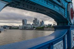 View to City of London from Tower Bridge on a cloudy evening. View to City of London with several modern buildings. Seen through Tower Bridge royalty free stock photo