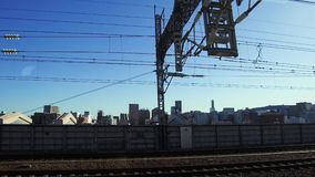 View to city from moving train or railway in japan. Transportation and urban concept - view to city from moving train or railway in japan stock footage