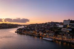 View to the city of Porto from D. Luis I bridge at sunset stock photos