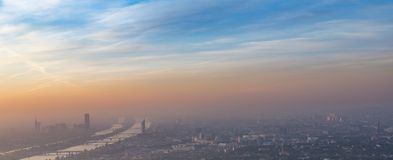 View to city of Vienna with river Danube in sunrise. Panoramic view to city of Vienna with river Danube in sunrise royalty free stock photo