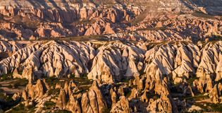 View to cliff dwellings in Cappadocia, Turkey. Ancient cavetown near Goreme on the sunset royalty free stock image