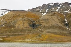 View to the cliffs the arctic shore of the polar archipelago of Spitsbergen near Longyearbyen, Norway. stock images