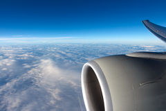 View to clouds through aircraft window Stock Images