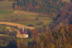 View to the countryside church in an autumn scenery Stock Images