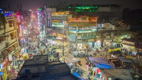 View to crowded street with shops, hotels, transport and people in Main Bazaar or Paharganj. Timelapse. stock video
