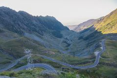 A view to a curve of the most famous, spectacular and dangerous. Road in Europe is a Transfagarasan road in Carpathian mountains, Romania. Potentially dangerous stock image