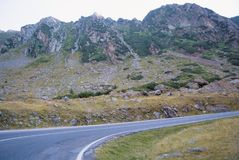 A view to a curve of the most famous, spectacular and dangerous. Road in Europe is a Transfagarasan road in Carpathian mountains, Romania. Potentially dangerous royalty free stock photos