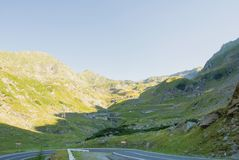 A view to a curve of the most famous, spectacular and dangerous. Road in Europe is a Transfagarasan road in Carpathian mountains, Romania. Potentially dangerous stock photography