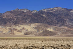 View to Devil's Golf Course and mountain range in Death Valley Stock Images