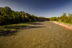 View to dirty river. Dirty river flowing in Hajokh�gorge among rocks with woods growing on top royalty free stock photography
