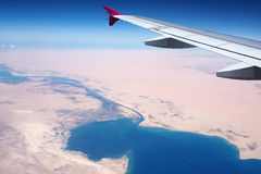 View to the Earth. (Red Sea, the Suez Canal) from a window of 10000 metres flying at height above sea level the airplane Royalty Free Stock Photos