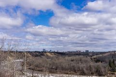 View to Edmonton North Saskatchewan river valley. And downtown in spring season with bird flying stock photos