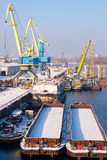 View to empty cargo dock with cranes and Stock Photos