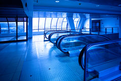 View to empty escalator in blue Stock Image