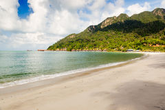 View to the empty tropical island beach. With and hotel near mountain, Langkawi, Malaysia Stock Photos