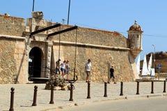 View to entrance gate of fortress Forte da Ponta da Bandeira in Lagos. Royalty Free Stock Photos