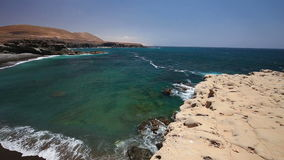 View to famous Ajuy black sand beach in the south of Fuerteventura, second biggest Canary island,  Spain. View to famous Ajuy black sand beach in the south of stock footage