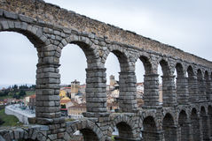 A view to famous ancient roman aqueduct of Segovia and old buildings of the town. Castille and Leon, Spain Stock Photo