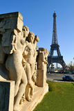 View to famous sculptures by Drivier at Trocadero gardens and la Tour Eiffel. Royalty Free Stock Photos