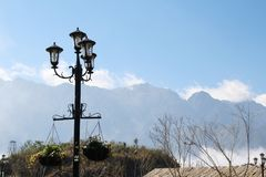 The view to Fansipan mountain from Fansipan legend par cable car station. A lantern in Fansipan Legend park at lower cable car station royalty free stock image