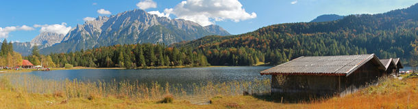 View to ferchensee and karwendel with boat houses in autumnal ge Stock Image