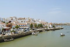 View to Ferragudo town from across the Rio Arade in Ferragudo, Portugal. Royalty Free Stock Photos