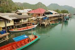 View to the fishermen village houses in Sam Roi Yot National park, Sam Roi Yot, Thailand. SAM ROI YOT, THAILAND - MARCH 30, 2012: View to the fishermen village Royalty Free Stock Photography