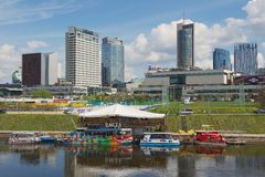 View to the floating restaurant with modern buildings at the background in Vilnius, Lithuania. Royalty Free Stock Photography