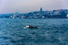 View to the Galata tower from the sea. Taking picture of the Galata Tower from the sea while driving on the boat Royalty Free Stock Images