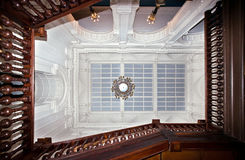 View to the glass ceiling throught grand staircase Royalty Free Stock Images