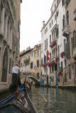 View to gondolas in channel in Venice from gondola Stock Images