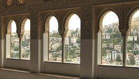 A view to Granada through a window in the palace of Alhambra royalty free stock photo