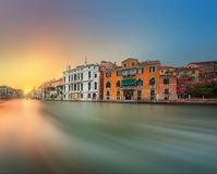 View to the grand canal and Academy in Venice. View to the grand canal and Museum of Academy from the Academy bridge in Venice, Italy Royalty Free Stock Photos