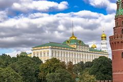 View to the Great Kremlin Palace. View to he Great Kremlin Palace in  Moscow, Russia  framed with Kremlin tower, green trees canopy and  cloudy sky background Stock Photography