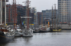 View to harbor with moored many tourist sailboats in 'HafenCity' district of Hamburg. Royalty Free Stock Image
