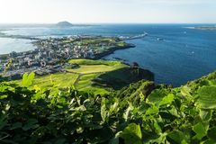 View to the harbour from Ilchulbong peak to Seongsan, Jeju Island, South Korea stock photo