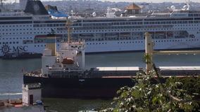 View to Havana harbour. With big cargo ship sailing near big white cruise liner ship stock video footage