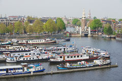 View to the historical building and canal with boats in Amsterdam, Netherlands. Royalty Free Stock Photo
