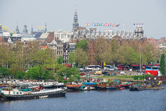 View to the historical building and canal with boats in Amsterdam, Netherlands. Stock Image