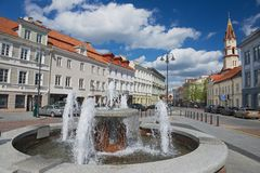 View to the historical buildings and fountain at the central part of Vilnius city, Lithuania. Stock Photos