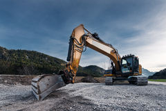View to huge orange mechanical shovel excavator Royalty Free Stock Photo