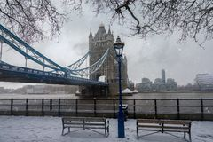 View to the iconic Tower Bridge in London, covered in snow stock photography
