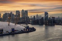 View to the illuminated financial district of London, Canary Wharf, United Kingdom royalty free stock photography