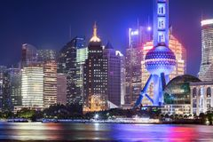 View to the illuminated office buildings in Pudong district, Shanghai, China. During evening time Royalty Free Stock Images