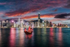 View to the illuminated skyline of Victoria Harbour in Hong Kong. Just after sunset stock images